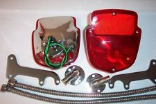 1953- 60 Ford F-100 stainless taillight kit, taillights, brackets, wire shields.