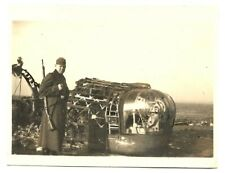 GERMAN MILITARY PHOTO - GERMANY WWII SOLDIER NEAR A PART OF A PLANE PHOTO