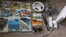 WHITE WII CONSOLE, STEERING WHEEL AND 11 GAMES