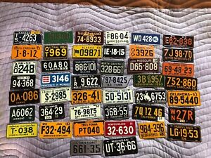 Lof of 44 1953-54 WHEATIES MINIATURE LICENSE PLATES  Domestic International