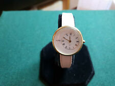 ladies alfex swiss watch with a gold tone case,& a white leather strap#b1+.