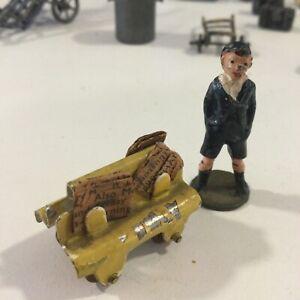 Vintage Minatoy? Metal Yellow Newspaper Cart Stand Boy Lead Railroad Train HO