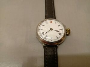 Silver import hallmarked London 1913 ladies watch on leather strap.