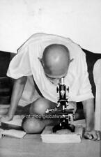 Old Photo. Gandhi Looking Into Microscope