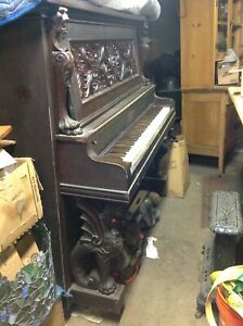 1890's horner carved griffin piano