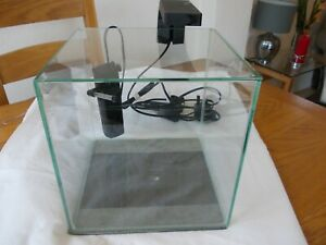 Tropical fish tank. clear glass square table top, 26inches square, 26inches high