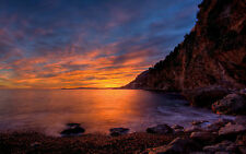 Encadrée Imprimer-falaises rocheuses surplombant l'océan au coucher du soleil (Photo Poster art