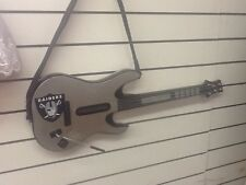 Custom made Oakland Raiders guitar hero guitar