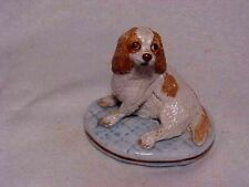 BASIL MATTHEWS CAVALIER KING CHARLES SPANIEL SITTING ON PILLOW