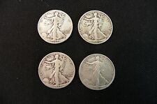 TWO EACH 1942-P AND 1945-D WALKING LIBERTY HALF DOLLARS