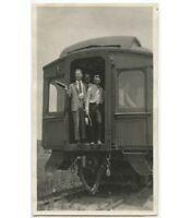 4 MEN WEARING TIES ONE W/ STRAW HAT IN RAILROAD CAR, TRAIN TRACK, VINTAGE PHOTO