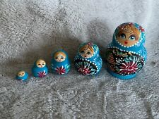Russian Doll Set With Tiny Button Heart In The Last Doll In Blue
