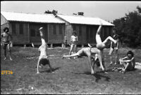 strong shirtless boys and girl jumping, swimsuit, 1970s vintage negative!  funny