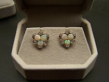 14k yellow gold post earrings three round opals 3.98mm each with diamond accents