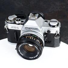 ^Canon AE-1 35mm Film SLR Camera w/ Canon 50mm f1.8 SC Lens