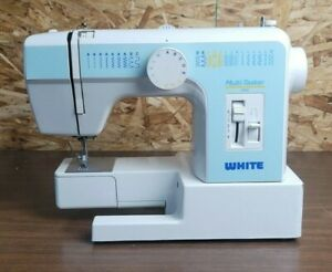 white sewing machine model 2200 with power cord/pedal