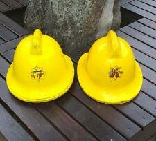 More details for two vintage firemen service helmets. humberside fire brigade. 1972 / 1988