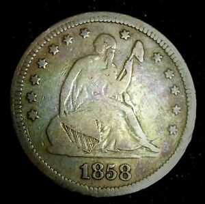 1858 USA Seated Liberty Silver Circulated Quarter With Toning  (855)
