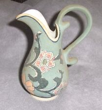Hand Crafted Porcelain Green Serving Pitcher Decorated with Hand Painted Flowers