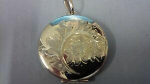 9 carat yellow gold hallmarked round engraved locket.Weighs 5.9gms.