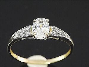 333 Gold  Ring mit gefaßten Zirkonia Steinen  Größe 50 mit 4 Krappen