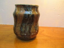 signed on bottom dmh 94 beautiful pottery vase