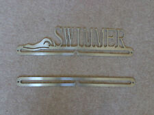 Swimming medal holder, with additional rail