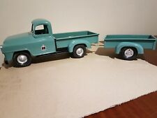 Tin Toy International pickup truck and trailer, Tru Scale, USA, 1950s