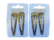 2 x packs making  4 gold animal print sleepies bend and snap