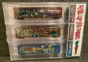 """N Scale """"War Of The Worlds"""" Grafitti Deluxe Innovations 170803 Wood Chip Gondola"""