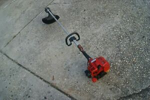 SHINDAIWA T231 GAS POWERED STRING TRIMMER  PLEASE WATCH THE VIDEO