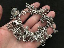 Vintage Sterling Silver Charm Bracelet with 30 Silver Charms. 108 grams