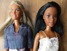 Barbie étnicos X 2 con ropa.