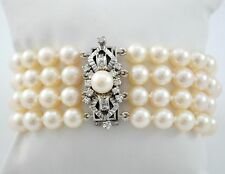 CULTURED PEARLS, DIAMONDS, EMERALDS AND 18K WHITE GOLD FOUR LINES BRACELET