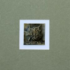 Hand burnish brass bas-relief mix media Maple Leaf with green  mat on white mat