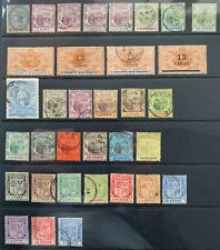 Mauritius, 34 early Mint and used Stamps (1887 - 1910) on stock sheet