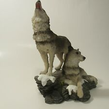 Two wolves figurines
