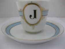 Coffee cup and saucer. Pastel blue and gilt trim.