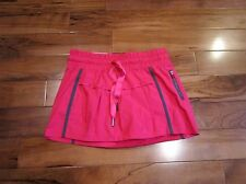 Lululemon leader of the track skirt size 2 bright senorita pink and grey