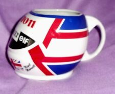 Nigel Mansell Formula 1 helmet shaped mug with steering wheel handle