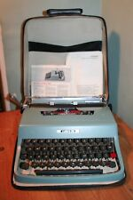 Vintage Olivetti Lettera 32 Typewriter, Mint Green, with case and instructions.