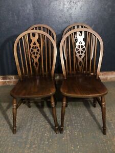 Set Of 4 Wheel Back Dining Chairs Windsor Style