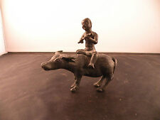 Old bronze Chinese old man sitting on water buffalo figure, statue sculpture