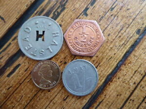 Vintage tokens x 4  A.MAY HALSTEAD ,HASSLEMERE CO.OP ,GRACE DARLING R.N.L.I (PM)