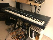 Korg triton extreme 88 key synthesizer with stand, slip cover, and throne