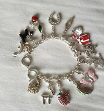 Avon Silver Plated Charm Bracelet with 14 Individual Charms BNWOB