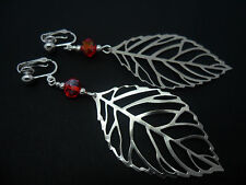A PAIR OF  BIG  DANGLY SILVER COLOUR  LEAF & RED CRYSTAL  CLIP ON EARRINGS. NEW.
