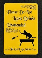 Please Do Not Leave Drinks Unattended, The Cat is An A-Hole 12 by 18 metal Sign.