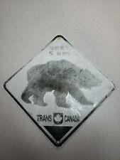 "Next 5 Km Bear Crossing Trans Canada Embossed Metal Sign. Measures 10"" X 10""."