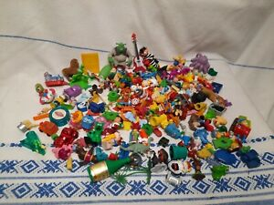 A large collection of different toys from Kinder Surprise, kids toys